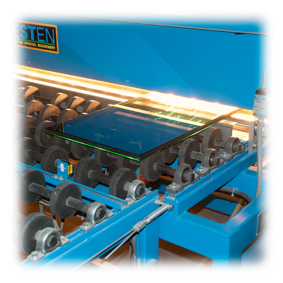 Insulated glass unit entering heat press ove